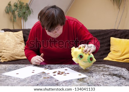 Disabled woman looking hopeless for little money - stock photo