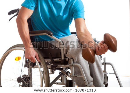 Disabled young athlete exercising at gym, horizontal - stock photo