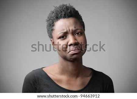 Disappointed african woman - stock photo