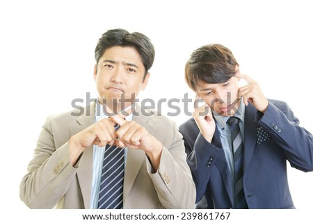 Disappointed Asian businessmen - stock photo