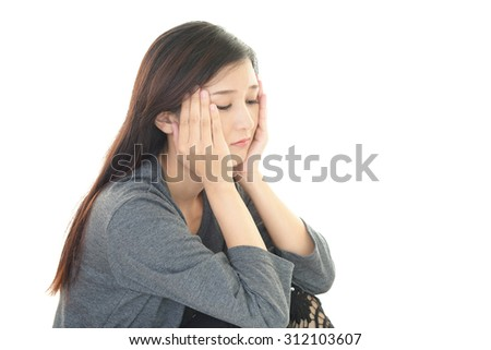 Disappointed Asian woman  - stock photo