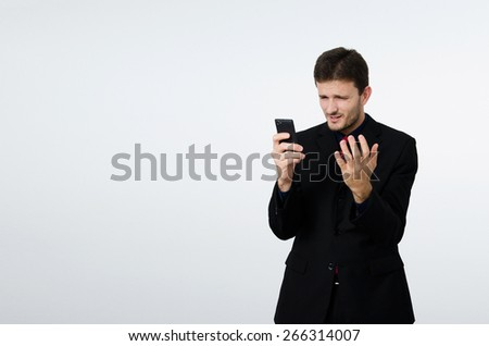 Disappointed businessman with cell phone in hand - stock photo