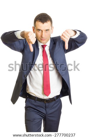 Disappointed businessman with thumbs downPortrait of an angry businessman giving his thumbs down sign - stock photo