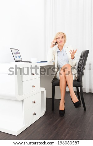 disappointed businesswoman problem call, sitting modern office desk, sad business woman using phone negative emotion unhappy talking cellphone - stock photo