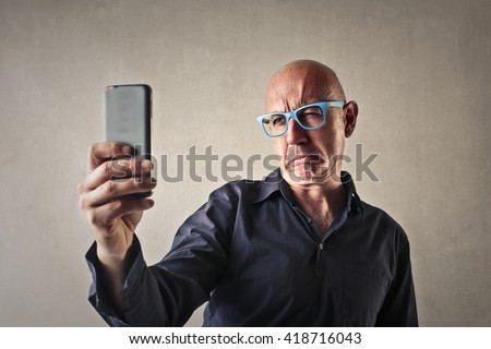 Disappointed doing a selfie - stock photo