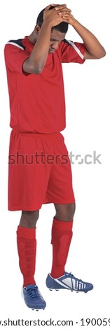 Disappointed football player looking down on white background - stock photo