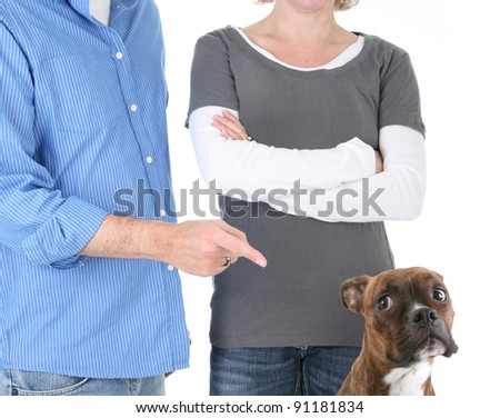 Disappointed Owners Scolding Boxer Dog - stock photo