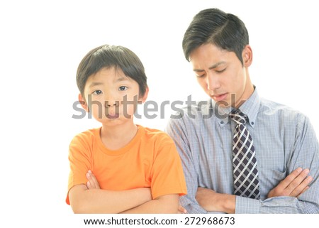Disappointed teacher with boy  - stock photo