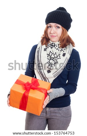 Disappointed winter woman holding present, isolated on white background. - stock photo