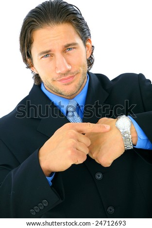 disappointed young businessman point to his watch - stock photo