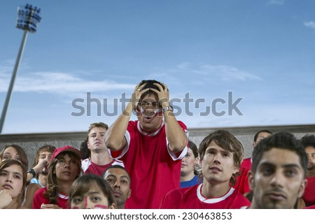 Disappointed Young Man at a Sporting Event - stock photo
