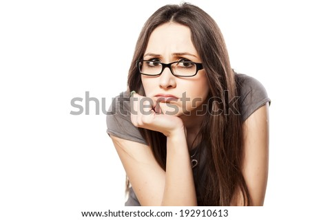 disappointed young woman with glasses - stock photo