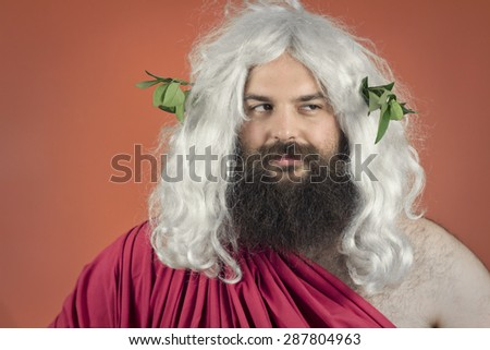 Disapproving zeus god or jupiter against orange background - stock photo