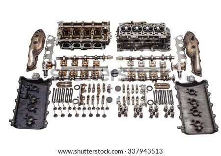 Disassembled for spare parts cylinder head. Each part is separately on a white background - stock photo