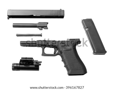 Disassembled handgun isolated on white background. Seperate pistol parts, magazine and torch. - stock photo