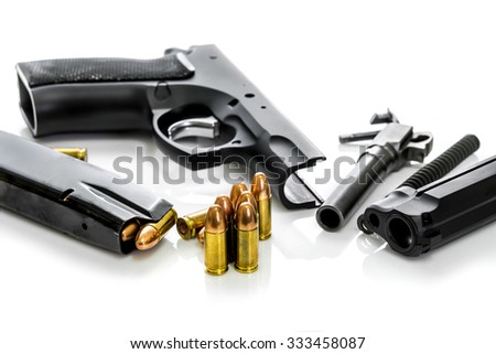 Disassembled handgun on white background,Selective  focused on the  Bullets - stock photo