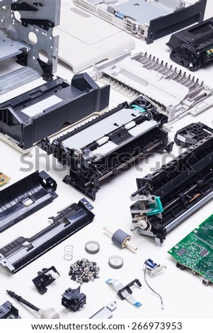 Disassembled printer on a white background. - stock photo