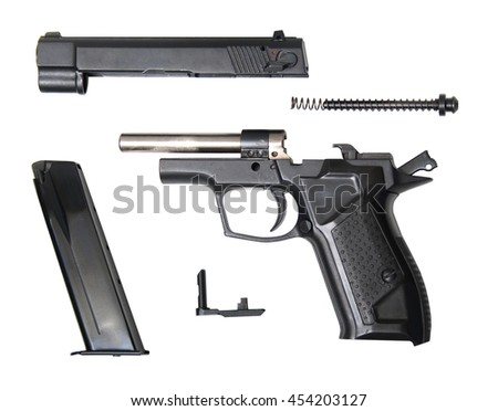 disassembled traumatic gun isolated on white - stock photo