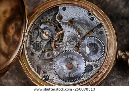 disassembled wrist watch lies on  table - stock photo