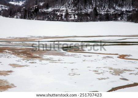 Disaster in a village with a polluted lake full with mining residuals in Romania, Alba, Geamana - stock photo