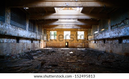 discarded ruin with old windows and wall, industrial window in concrete wall - stock photo