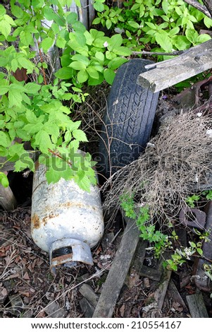 discarded trash in the forest - stock photo
