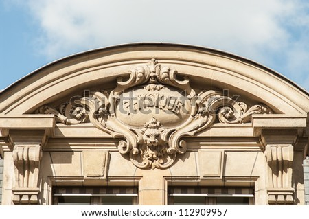 """Discipline sign on the top of the building of the University Sorbonne, """"physics"""" - stock photo"""