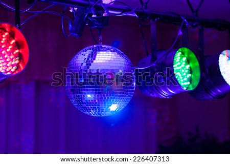 Disco ball and light projectors - stock photo