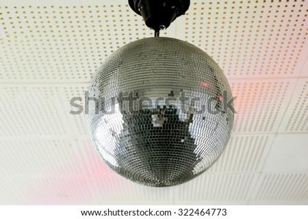 Disco ball on the white wall - stock photo