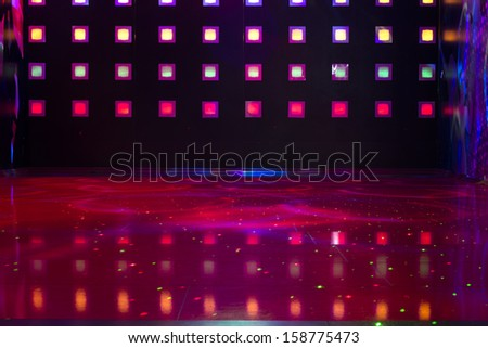 Disco with colorful lights. Dancing - stock photo
