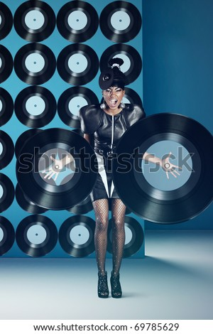 Disco woman screaming with vinyl records - stock photo