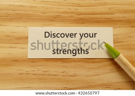 Discover your strengths- the concept of  entrepreneur management message on wood background with pen / pencil - stock photo