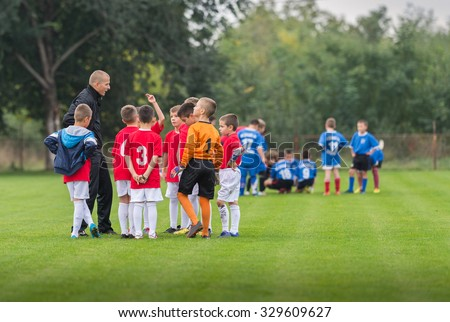 Discussion of the kid soccer team before the match - stock photo