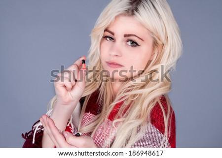 diseased eyes girl in plaid takes pills - stock photo