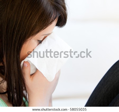Diseased female teenager with tissues against white background - stock photo