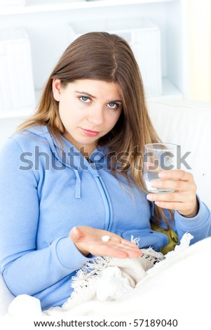 Diseased woman sitting at home with a glass in her hand - stock photo