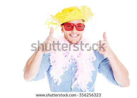 Disguised young man showing thumbs up - photo booth photo - stock photo