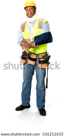 Disgusted Male Construction Worker with short black hair in uniform using neck brace and having arm in a sling - Isolated - stock photo