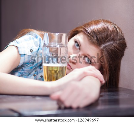 disgusting looking woman with a glass of beer - stock photo