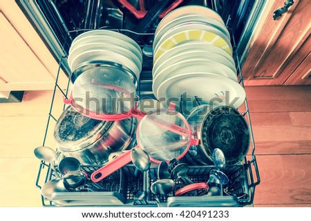 Dish in dishwasher - stock photo