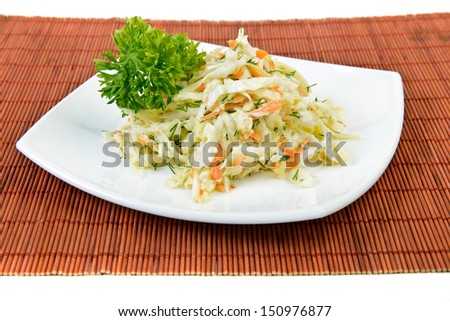 Dish of cabbage and carrot salad  (coleslaw) at restaurant over white - stock photo