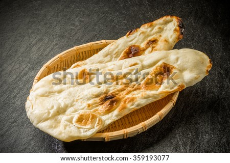 Dish of naan India - stock photo