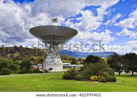 Dish of radio telescope antenna turned towards the blue sky at Tidbinbilla deep space research station of Australia. Free for public visitor centre to promote science and education. - stock photo