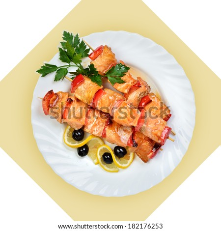 Dish of salmon fish on skewer on white plate. Isolated image with white bckground. View from above. still life of setout table Russian cuisine - stock photo