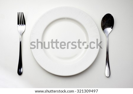 Dish spoon and fork on the table - stock photo