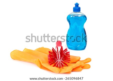 Dish washing brush with rubber gloves and dish washing detergent over white - stock photo