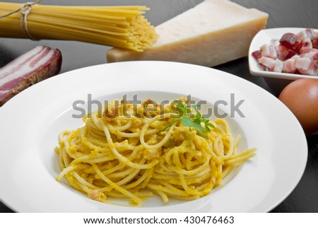 dish with carbonara's spaghetti and ingredients - stock photo