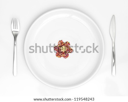 dish with flower from candys - stock photo