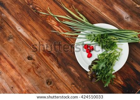 Dish with garlic, lettuce and radish - stock photo