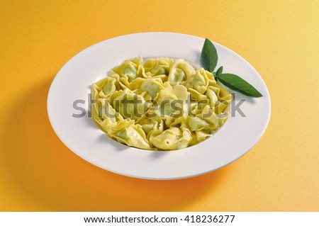 Dish with portion of ravioli with butter and sage  - stock photo